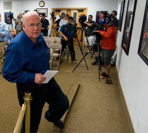 Trent Nelson  |  The Salt Lake Tribune Hildale Mayor Phillip Barlow leaves a press conference after nine people were killed and five remained missing Tuesday morning, the day after an SUV and a van were washed off a road during a flash flood in this polygamous Utah-Arizona border community.