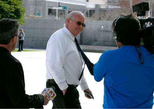 Hildale, Utah mayor Phillip Barlow, center, arrives at the Sandra Day O'Connor United States District Court where a federal civil rights trial against the polygamous towns of Hildale and Colorado City, Ariz., which are located on the Arizona-Utah border, is set to begin, Tuesday, Jan. 19, 2016, in Phoenix. (AP Photo/Ralph Freso)