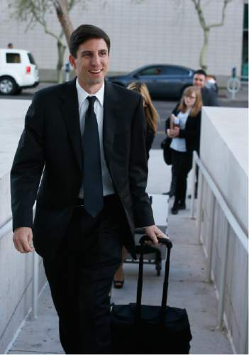 Attorney Jeff Matura, representing the town of Colorado City, Ariz., and other defense attorneys arrive at the Sandra Day O'Connor United States District Court where a federal civil rights trial against two polygamous towns on the Arizona-Utah line begins Wednesday, Jan. 20, 2016, in Phoenix. (AP Photo/Ross D. Franklin)