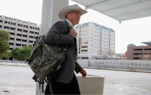 FILE - In this Jan. 28, 2016, file photo, Texas Ranger Nick Hanna, who was involved in the case against Warren Jeffs on the Fundamentalist Church of Jesus Christ of Latter Day Saints sect compound near San Angelo, Texas in 2008, arrives at the Sandra Day O'Connor U.S. District Court. Two polygamous towns on the Utah-Arizona border violated the constitutional rights of nonbelievers by denying them basic services such as police protection, building permits and water hookups, a jury said Monday, March 7, 2016. (AP Photo/Ross D. Franklin, File)