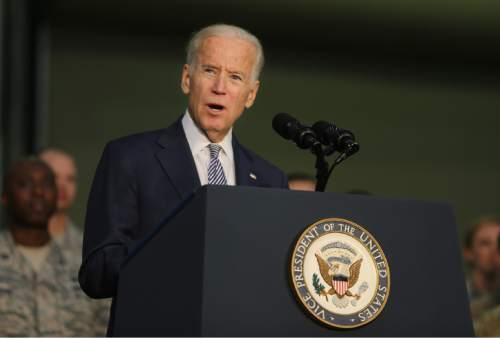 Joe Biden, the U.S. Vice President talks to the U.S. military personnel at an Air Base in United Arab Emirates, Monday, March 7, 2016. (AP Photo/Kamran Jebreili)