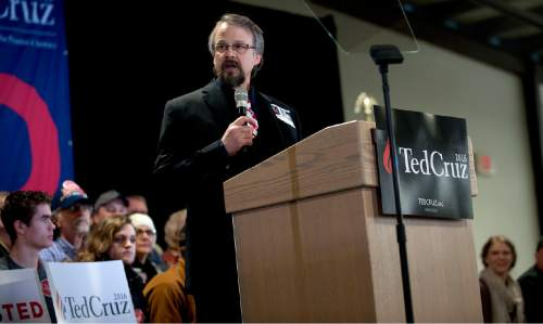 In a Saturday, March 5, 2016 photo, Coeur d'Alene pastor Tim Remington leads the prayer, during the rally for Republican presidential hopeful Ted Cruz at the Kootenai County Fairgrounds in Coeur d'Alene, Idaho. He was shot six times March 6 as he was leaving the Altar Church after Sunday services. (Kathy Plonka / The Spokesman-Review, via AP)