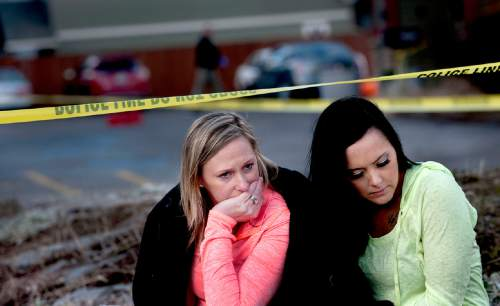 Amanda Padula, left as she and Deborah Young sit outside Altar Church in Coeur d'Alene, Idaho where pastor Tim Remington was shot six times as he was leaving services on Sunday, March 6, 2016. The two women benefited from Pastor Remingtonís Good Samaritan Rehabilitation program. (Kathy Plonka/The Spokesman-Review via AP)