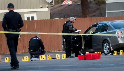 Coeur d'Alene police investigate the scene where Coeur d'Alene pastor Tim Remington was shot six times as he was leaving the Altar Church in Coeur d'Alene, Idaho after services on Sunday, March 6, 2016, but was expected to survive.  (Kathy Plonka/The Spokesman-Review, via AP)
