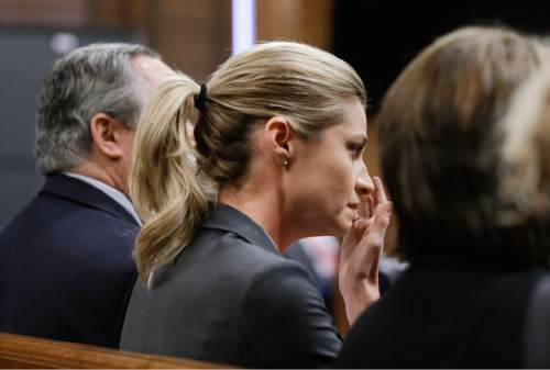 Sportscaster and television host Erin Andrews wipes tears as the verdict is read Monday, March 7, 2016, in Nashville, Tenn. A jury has awarded Andrews $55 million in her lawsuit against a stalker who bought a hotel room next to her and secretly recorded a nude video, finding that the hotel companies and the stalker shared in the blame. (AP Photo/Mark Humphrey, Pool)