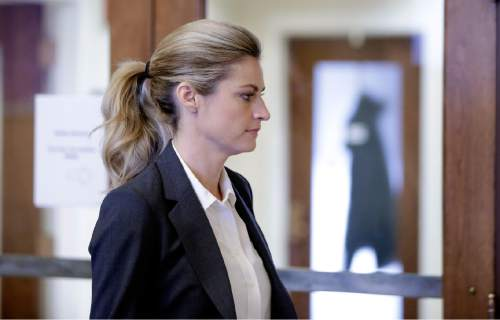 Sportscaster and television host Erin Andrews walks to the courtroom Monday, March 7, 2016, in Nashville, Tenn. Andrews' $75 million lawsuit against the franchise owner and manager of a luxury hotel and a man who admitted to making secret nude recordings of her in 2008 is to be turned over to the jury Monday. (AP Photo/Mark Humphrey)