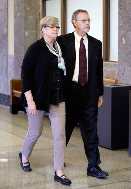 Paula and Steven Andrews, the parents of sportscaster and television host Erin Andrews, walk to the courtroom Monday, March 7, 2016, in Nashville, Tenn. Erin Andrews' $75 million lawsuit against the franchise owner and manager of a luxury hotel and a man who admitted to making secret nude recordings of her in 2008 is to be turned over to the jury Monday. (AP Photo/Mark Humphrey)