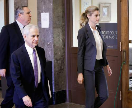 Sportscaster and television host Erin Andrews walks to the courtroom with attorneys Bruce Broillet, center, and Scott Carr, left, Monday, March 7, 2016, in Nashville, Tenn. Andrews' $75 million lawsuit against the franchise owner and manager of a luxury hotel and a man who admitted to making secret nude recordings of her in 2008 is to be turned over to the jury Monday. (AP Photo/Mark Humphrey)