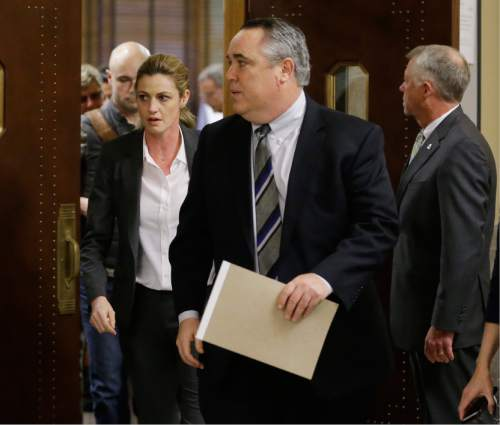 Sportscaster and television host Erin Andrews, left, leaves the courtroom with attorney Scott Carr, center, after the verdict was read in her lawsuit Monday, March 7, 2016, in Nashville, Tenn. A jury has awarded Andrews $55 million in her lawsuit against a stalker who bought a hotel room next to her and secretly recorded a nude video, finding that the hotel companies and the stalker shared in the blame. (AP Photo/Mark Humphrey)