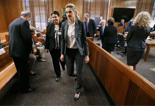 Sportscaster and television host Erin Andrews, center, leaves the courtroom after her lawsuit was given over to the jury Monday, March 7, 2016, in Nashville, Tenn. Andrews has filed a $75 million lawsuit against the franchise owner and manager of a luxury hotel and a man who admitted to making secret nude recordings of her in 2008. (AP Photo/Mark Humphrey, Pool)