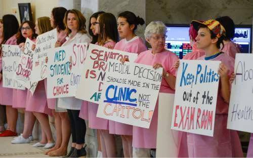 Francisco Kjolseth | Tribune file photo Planned Parenthood advocates held a silent protest at the Utah Capitol Friday in opposition to SB234, which requires anesthesia for a fetus before an abortion after 20 weeks of gestation.