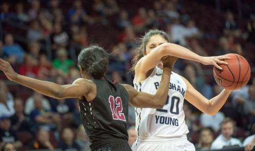 Rick Egan  |  The Salt Lake Tribune  Santa Clara Broncos guard Kyla Martin (12) tries to stop Brigham Young Cougars guard Cassie Broadhead (20) in basketball action in the West Coast Conference Semifinals, at the Orleans Arena in Las Vegas, Saturday, March 7, 2016.