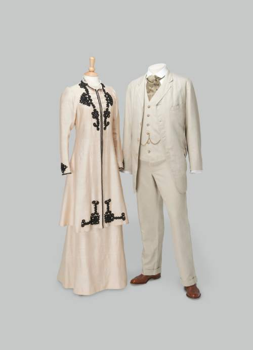 "This undated image provided by the Driehaus Museum in Chicago shows two costumes from ""Downton Abbey"" that are part of an exhibition, ""Dressing Downton: Changing Fashion for Changing Times,"" on view at the Driehaus. The exhibition is traveling around the U.S. for the next two years. (Richard H. Driehaus Museum via AP)"