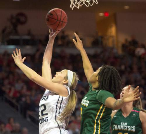 Rick Egan  |  The Salt Lake Tribune  Brigham Young Cougars forward Kalani Purcell (32) goes in for two points, as San Francisco Lady Dons forward Dagny McConnell (2) defends, in the West Coast Conference Championship game, at the Orleans Arena in Las Vegas, Tuesday, March 8, 2016.