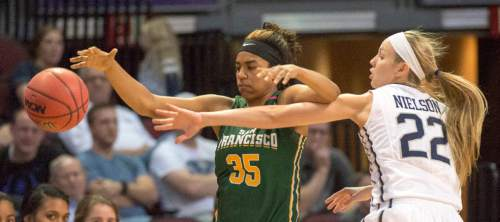 Rick Egan  |  The Salt Lake Tribune  Brigham Young Cougars guard/forward Kristine Fuller Nielson (22) keeps the ball from San Francisco Lady Dons guard Kalyn Simon (35), in the West Coast Conference Championship game, at the Orleans Arena in Las Vegas, Tuesday, March 8, 2016.