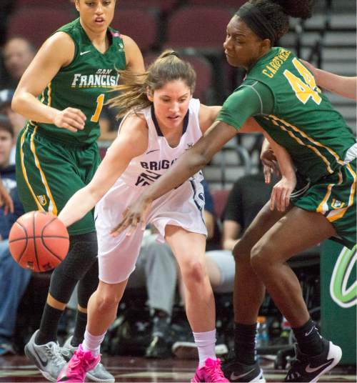 Rick Egan  |  The Salt Lake Tribune  Brigham Young Cougars guard Cassie Broadhead (20) tries to dribble, as San Francisco Lady Dons forward Hashima Carothers (44) defends,  in the West Coast Conference Championship game, at the Orleans Arena in Las Vegas, Tuesday, March 8, 2016.