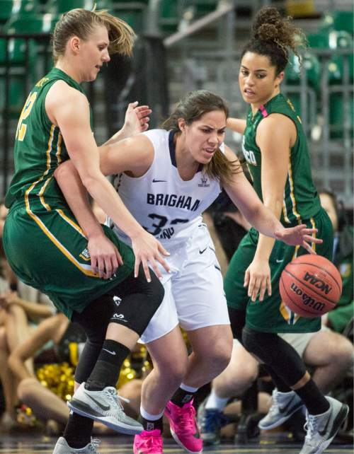Rick Egan  |  The Salt Lake Tribune  Brigham Young Cougars forward Kalani Purcell (32) tries to get the ball down court as San Francisco Lady Dons forward Taylor Proctor (32)uses her knee to stop her, in the West Coast Conference Championship game, at the Orleans Arena in Las Vegas, Tuesday, March 8, 2016.