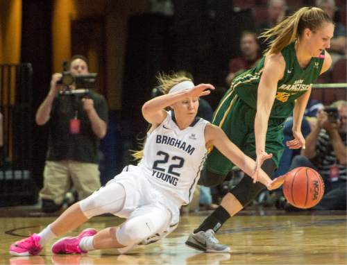 Rick Egan  |  The Salt Lake Tribune  Brigham Young Cougars guard/forward Kristine Fuller Nielson (22) steals the ball from San Francisco Lady Dons forward Taylor Proctor (32), in the West Coast Conference Championship game, at the Orleans Arena in Las Vegas, Tuesday, March 8, 2016.