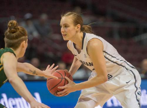 Rick Egan  |  The Salt Lake Tribune  Brigham Young Cougars guard Lexi Eaton Rydalch (21) prepares to make her move, as San Francisco Lady Dons guard Rachel Howard (11) defends, in the West Coast Conference Championship game, at the Orleans Arena in Las Vegas, Tuesday, March 8, 2016.