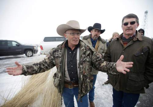 FILE - In this Jan. 9, 2016 file photo, LaVoy Finicum, a rancher from Arizona, speaks to the media after members of an armed group  along with several other organizations arrive at the at the Malheur National Wildlife Refuge near Burns, Ore.  The FBI and Oregon State Police arrested the leaders of an armed group that has occupied a national wildlife refuge for the past three weeks during a traffic stop that prompted gunfire — and one death — along a highway through the frozen high country. The Oregonian reported that  Finicum was the person killed, citing the man's daughter. (AP Photo/Rick Bowmer)