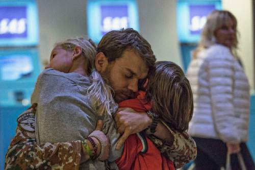 """   Magnolia Pictures  Claus Pedersen (Pilou Asbaek), a Danish military officer, greets his children when he returns home from Afghanistan, in Tobias Lindholm's drama """"A War."""""""