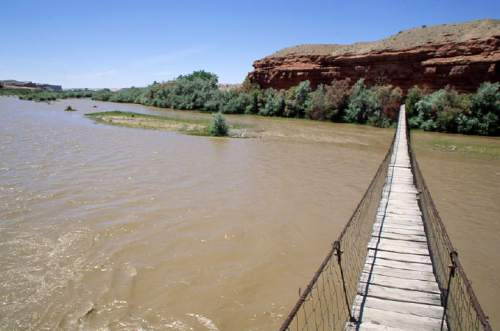 Al Hartmann  |  The Salt Lake Tribune   Cable suspension bridge that crosses the San Juan River a couple miles east of Blufff, UT.