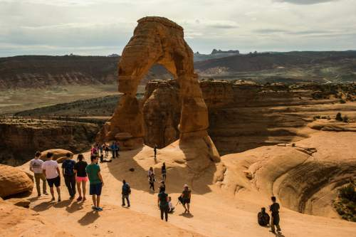 Chris Detrick     The Salt Lake Tribune Visitors take pictures and hike around Delicate Arch in Arches National Park Saturday March 5, 2016.