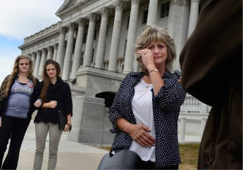 "Scott Sommerdorf   |  The Salt Lake Tribune   LaVoy Finicum's widow, Jeanette wipes away a tear as she talks about what she called her husband's ""assasination"" while speaking to the media prior to a rally at the Utah State Capitol, Saturday, March 5, 2016."