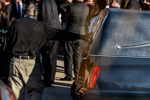 "Trent Nelson  |  The Salt Lake Tribune A man openly carrying two handguns pays his respect to the hearse, at the funeral for Robert ""LaVoy"" Finicum, in Kanab, Friday February 5, 2016. Finicum was shot and killed by police during a January 26 traffic stop. Finicum was part of the armed occupation of an Oregon wildlife refuge."