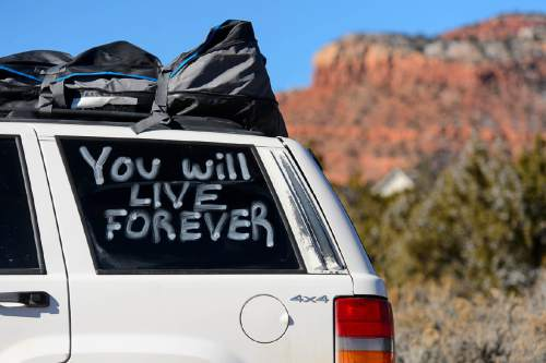 "Trent Nelson  |  The Salt Lake Tribune ""You Will Live Forever"", written on a vehicle at the funeral for Robert ""LaVoy"" Finicum, in Kanab, Friday February 5, 2016. Finicum was shot and killed by police during a January 26 traffic stop. Finicum was part of the armed occupation of an Oregon wildlife refuge."