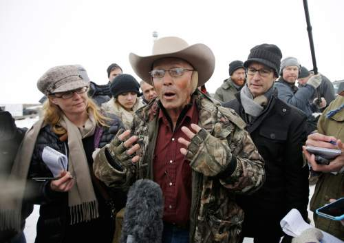 "LaVoy Finicum, a rancher from Arizona, who is part of the group occupying the Malheur National Wildlife Refuge speaks with reporters during a news conference at the the refuge Tuesday, Jan. 5, 2016, near Burns, Ore. At the time, law enforcement had yet to take any action against the group numbering close to two dozen who are upset over federal land policy. Finicum said the group would examine the underlying land ownership transactions to begin to ""unwind it,"" stating he was eager to leave Oregon.  (AP Photo/Rick Bowmer)"