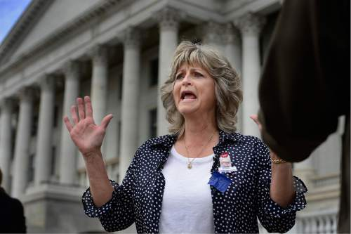 "Scott Sommerdorf   |  The Salt Lake Tribune   LaVoy Finicum's widow, Jeanette speaks about what she called her husband's ""assasination"" and describes that she feels he had his hands up when he was shot, as she was speaking to the media prior to a rally at the Utah State Capitol on Saturday."