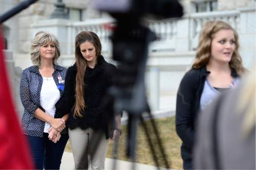 Scott Sommerdorf   |  The Salt Lake Tribune   LaVoy Finicum's family, widow Jeanette, far left, daughter Thara Tenney, and Brittney Beck at far right speaking to the media as they held a rally at the Utah State Capitol, Saturday, March 5, 2016.