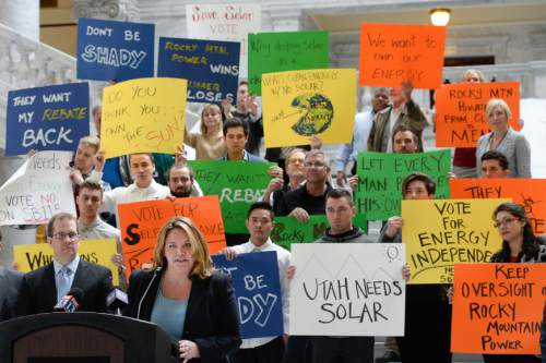 Francisco Kjolseth   The Salt Lake Tribune Brandy Smith, communications coordinator for Utah Clean Energy is joined by opponents of SB115, the sustainable transportation and energy plan act, which passed in the Senate and now goes to the House for a vote. Opponents cite the bill for raising raising rates and favoring Rocky Mountain Power at the expense of customers along with the potential to kill hundreds of solar jobs in the state.