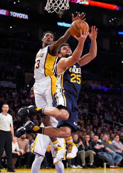 Utah Jazz guard Raul Neto, right, of Brazil, shoots as Los Angeles Lakers guard Lou Williams defends during the second half of an NBA basketball game Sunday, Jan. 10, 2016, in Los Angeles. The Jazz won 86- 74. (AP Photo/Mark J. Terrill)