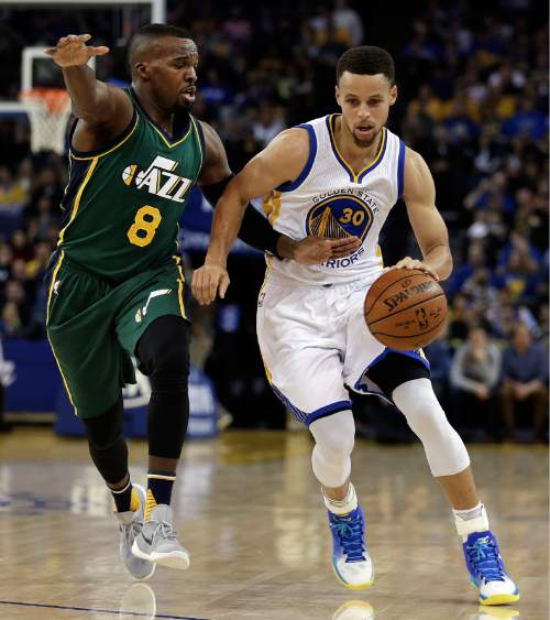 Golden State Warriors' Stephen Curry, right, drives the ball against Utah Jazz's Shelvin Mack (8) during the first half of an NBA basketball game Wednesday, March 9, 2016, in Oakland, Calif. (AP Photo/Ben Margot)