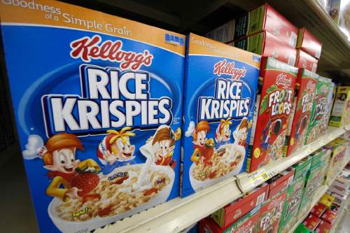 FILE - In a Wednesday, July 18, 2012, file photo, Kellogg's cereals are on display at a Pittsburgh grocery market. Kellogg says a criminal investigation is underway after a video surfaced online showing a man urinating on one of its factory assembly lines. The company says it learned of the video Friday, March 11, 2016, and immediately alerted authorities. It says the criminal investigation is being conducted by the U.S. Food and Drug Administration. Kellogg said its own investigation determined the video was recorded at its Memphis, Tenn., factory in 2014. (AP Photo/Gene J. Puskar, File)