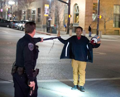 Lennie Mahler  |  The Salt Lake Tribune Police stop Selam Mohammad as the 19-year-old walked away from a crowd that formed after an officer-involved shooting at 200 South Rio Grande Street in Salt Lake City on Saturday.