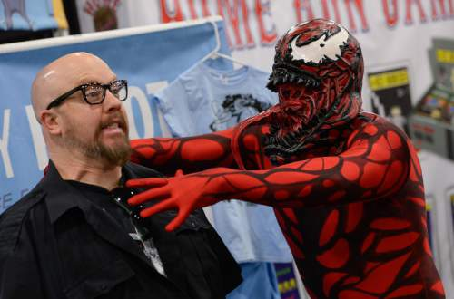 "Franciso Kjolseth  |  The Salt Lake Tribune RobX Musgrave strikes a pose with Lance Monson as ""Carnage,"" at the Salt Palace Convention Center for FanX 2014."