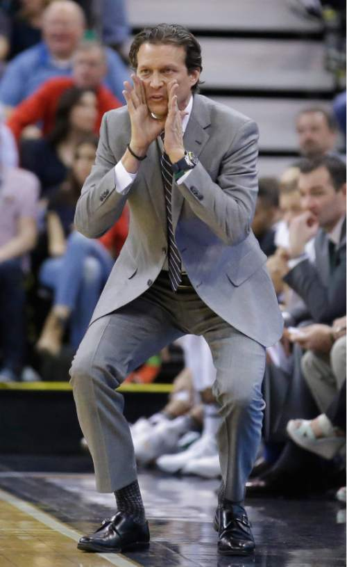 Utah Jazz head coach Quin Snyder shouts to his team during the second quarter of an NBA basketball game against the Washington Wizards Friday, March 11, 2016, in Salt Lake City. (AP Photo/Rick Bowmer)