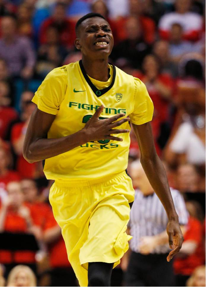 Oregon forward Chris Boucher reacts after scoring a 3-point shot against Utah during the first half of an NCAA college basketball game in the championship of the Pac-12 men's tournament Saturday, March 12, 2016, in Las Vegas. (AP Photo/John Locher)