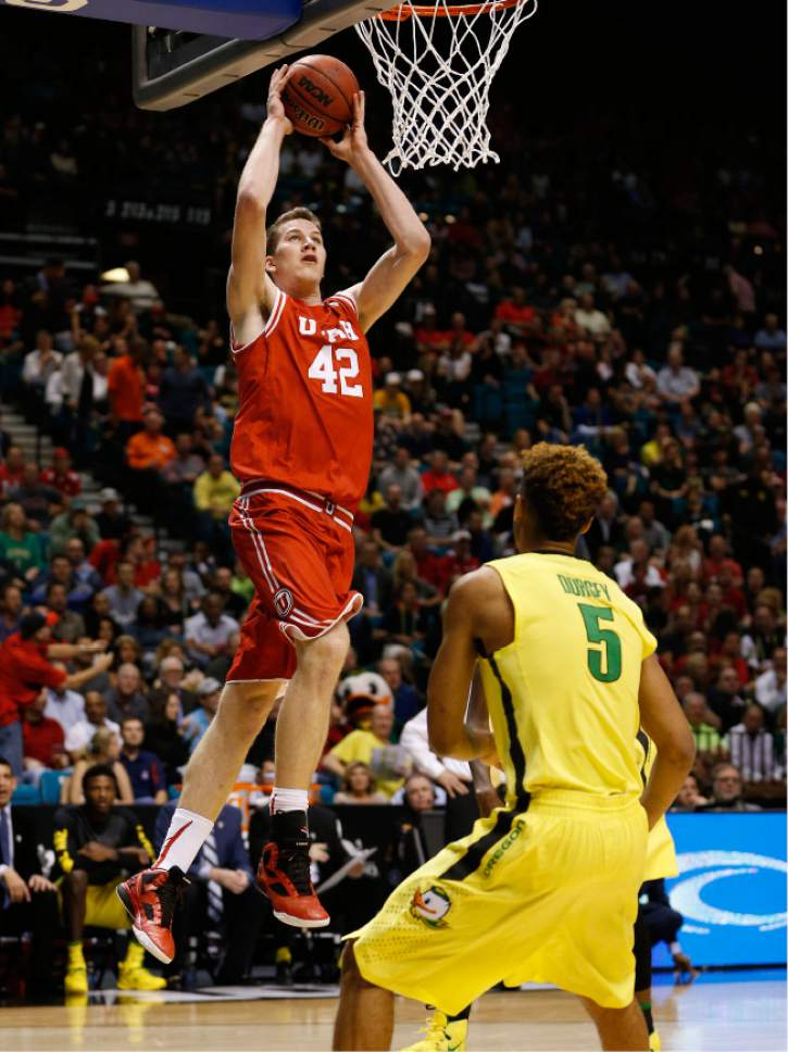 Utah forward Jakob Poeltl (42) dunks in front of Oregon guard Tyler Dorsey (5) during the first half of an NCAA college basketball game in the championship of the Pac-12 men's tournament Saturday, March 12, 2016, in Las Vegas. (AP Photo/John Locher)