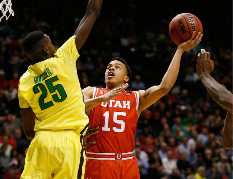 Utah guard Lorenzo Bonam (15) shoots around Oregon forward Chris Boucher (25) during the first half of an NCAA college basketball game in the championship of the Pac-12 men's tournament Saturday, March 12, 2016, in Las Vegas. (AP Photo/John Locher)