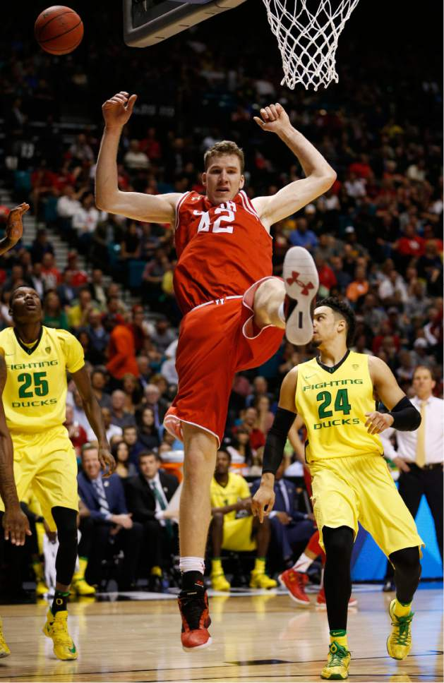 Utah forward Jakob Poeltl (42) comes down to the court after being fouled during the first half of the team's NCAA college basketball game against Oregon for the championship of the Pac-12 men's tournament Saturday, March 12, 2016, in Las Vegas. (AP Photo/John Locher)
