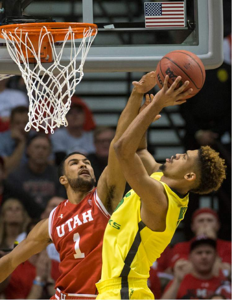 Rick Egan  |  The Salt Lake Tribune  Oregon Ducks guard Tyler Dorsey (5) tales a shot, as Utah Utes guard Isaiah Wright (1) defends, in the PAC-12 Basketball Championship game, The Utah Utes vs.The Oregon Ducks, at the MGM Arena, in Las Vegas, Friday, March 12, 2016.