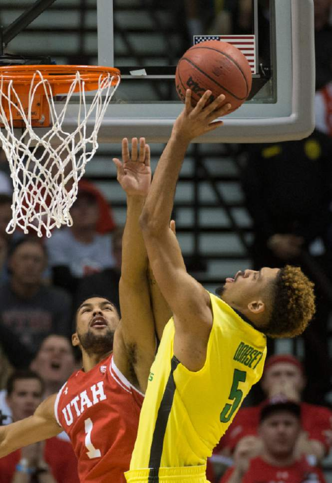 Rick Egan  |  The Salt Lake Tribune  Oregon Ducks guard Tyler Dorsey (5) shoots over Utah Utes guard Isaiah Wright (1), in the PAC-12 Basketball Championship game, The Utah Utes vs.The Oregon Ducks, at the MGM Arena, in Las Vegas, Friday, March 12, 2016.