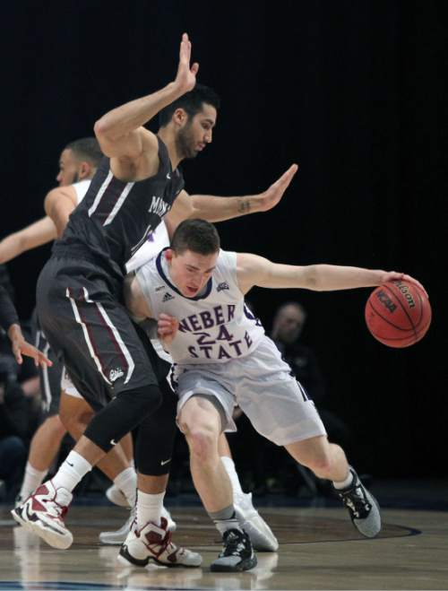 Weber State guard McKay Cannon (24) drives the ball around  Montana forward Martin Breunig (12) during the first half of an NCAA college basketball game in the championship of the Big Sky conference men's tournament in Reno, Nev., Saturday, March 12, 2016. (AP Photo/Lance Iversen)