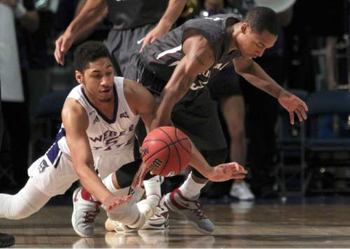 Weber State guard Cody John (5) and Montana guard Walter Wright (5) scramble for a loose ball in the first half of an NCAA college basketball game for the championship of the Big Sky conference men's tournament in Reno, Nev., Saturday, March 12, 2016. (AP Photo/Lance Iversen)