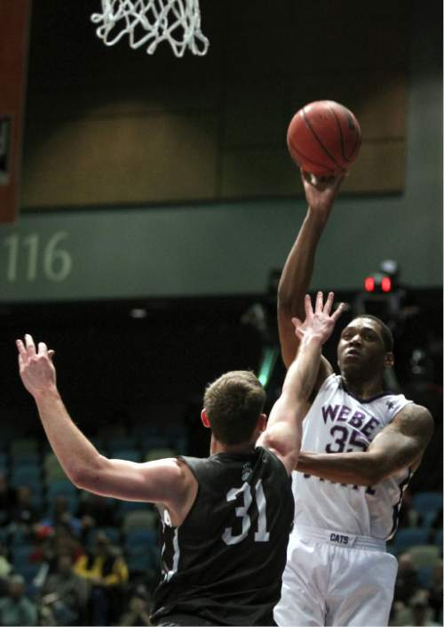Weber State forward Kyndahl Hill (35) shoots in front of Montana 31 forward Jack Lopez (31) during the first half of an NCAA college basketball game in the championship of the Big Sky conference men's tournament in Reno, Nev., Saturday, March 12, 2016. (AP Photo/Lance Iversen)