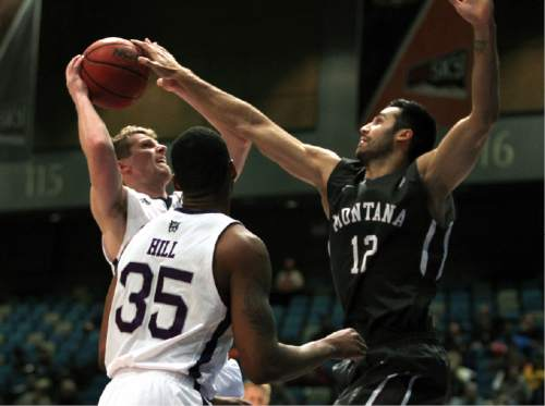 Weber State forward Dusty Baker (25) shoots in front of Montana forward Martin Breunig (12) in the first half of an NCAA college basketball game for the championship of the Big Sky conference men's tournament in Reno, Nev., Saturday, March 12, 2016. (AP Photo/Lance Iversen)